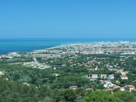 livorno: Spectacular aerial panorama of Livorno city made from the nearby hills of Montenero on sunny day, Tuscany Italy . Photo taken with polarized filter