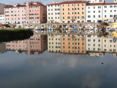 livorno: Picturesque ancient residential neighborhood near the city center of Livorno . Tuscany, Italy . Houses and boats are reflected in the tranquil water Stock Photo