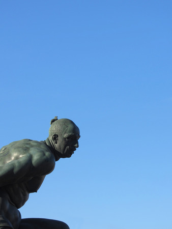 The monument Quattro Mori ( of the Four Moors ) in Livorno city . View of one of the four moors against the blue sky . Tuscany, Italy Stock Photo