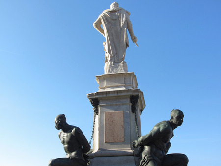 The monument Quattro Mori ( of the Four Moors ) in Livorno city . Rear view of the monument against the blue sky . Tuscany, Italy Stock Photo