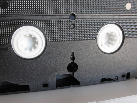 videocassette: Back view of a single outdated videocassette . Old video tape
