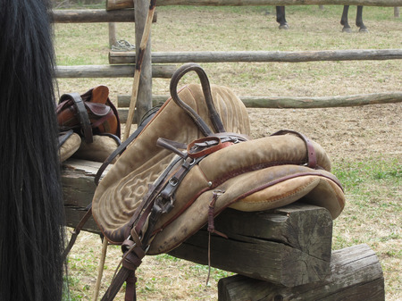 Leather saddle horse on a barrier in the stable