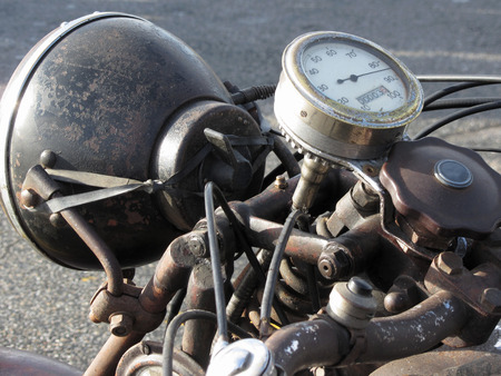 Vintage motorcycle standing on the road . Closeup of motorbike headlight and speedometer 스톡 콘텐츠