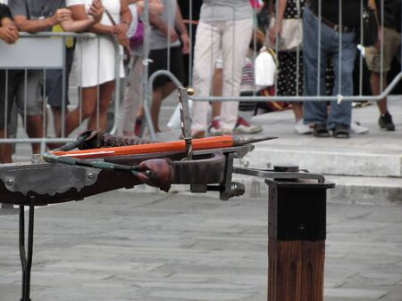 Close up of a Medieval heavy crossbow on stand ready to shoot