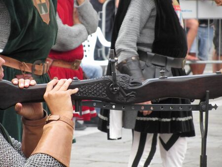 Man medieval archer hand holds his heavy crossbow and aiming at the target Standard-Bild