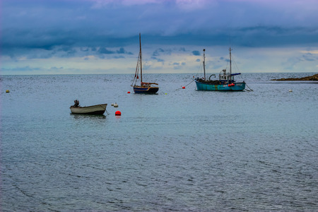 Fishing boats anchored at Lulworth Cove Editorial
