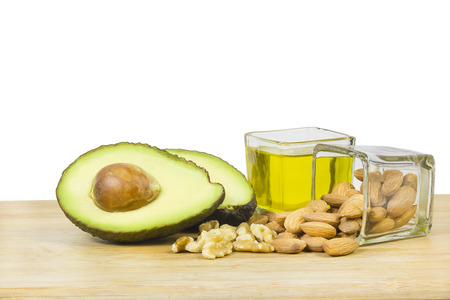 Good fats diet avocado dry fruits and oil Stock Photo