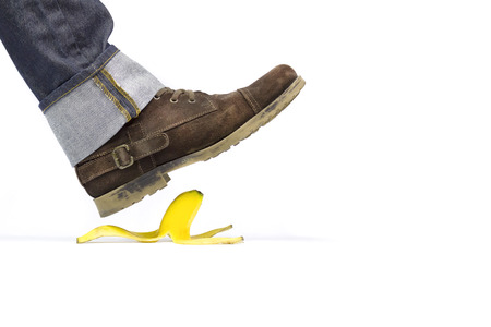 banana skin: About to slide with a banana peel Stock Photo