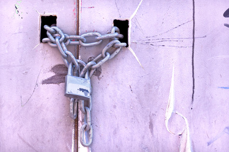 keep gate closed: Padlock and chain closing a door Stock Photo
