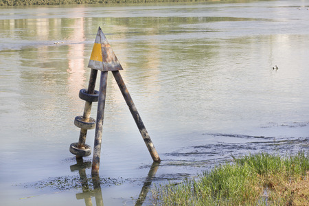 depth measurement: Water level sign in a river Stock Photo