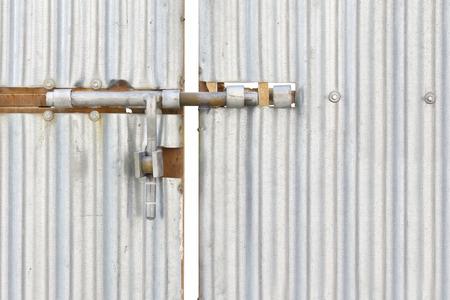 door bolt: Bolt door on a gray door Stock Photo
