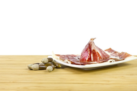 iberian: Iberian ham with acorns over a white background acorn Jamn