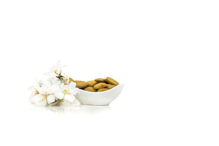 recipient: Recipient With almonds and almond white flowers.