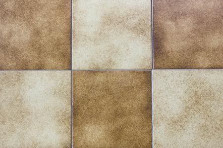 Imagen de fondo de baldosas de cerámica de color amarillo y marrón. Foto de archivo