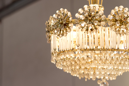 Closeup image of decorative details from a chandelier lamp.