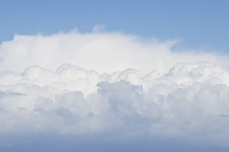 Background image of white fluffy clouds.