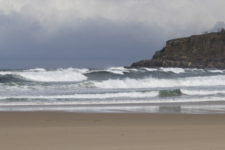 Cloudy day in a beach with strong swell