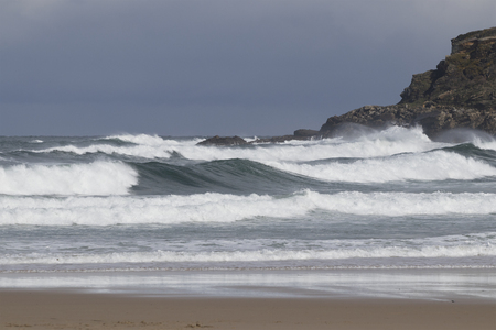 Background image of strong swell in a storm at the beach. Foto de archivo