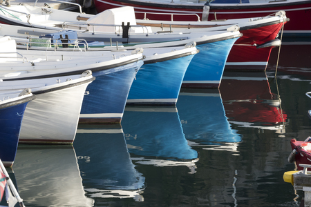 Bows of small fisherman boats in perspective. Foto de archivo