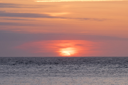 Background image of a sunset with a colorful sky at the sea (San Sebastian, Spain). Foto de archivo