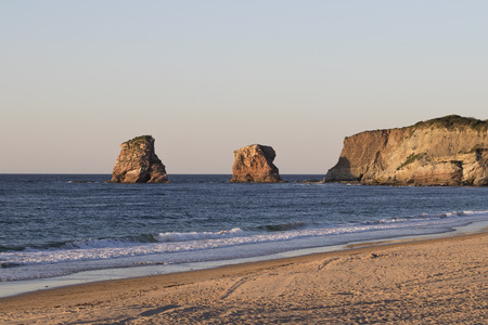 Les deux jumeaux (the twins rocks) rock formation at sunset (Hendaye, France).