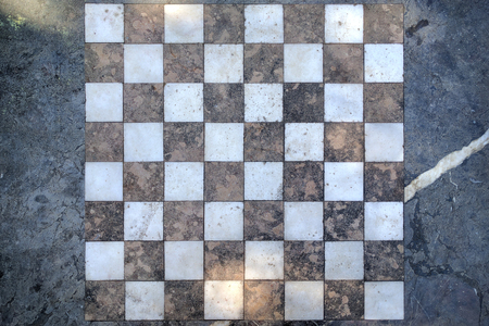 Background image of a metamorphic stone surface with a chessboard on it. Foto de archivo