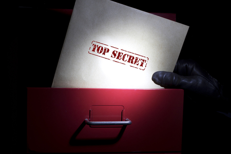 Looking for top secret documents in a dark.