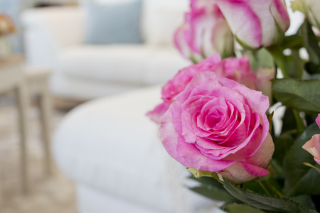 Closeup image of a decorative rose in a living room.