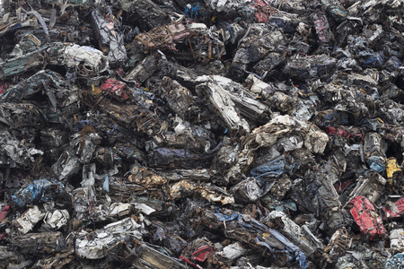 Background image of mountain of scraps cars.
