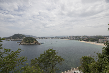 Wide angle view of La concha bay in Donostia (Guipuzcoa, Basque country, Spain).