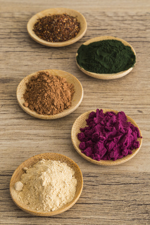 maca root: Powdered superfoods in bamboo dishes