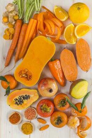 Orange coloured fruit and vegetables Standard-Bild
