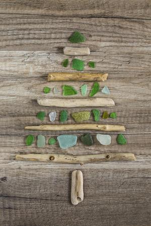 Driftwood christmas tree with polished green glass Standard-Bild
