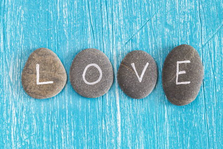 written: Love written on pebbles Stock Photo