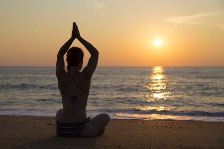 Sunset yoga on the beach photo