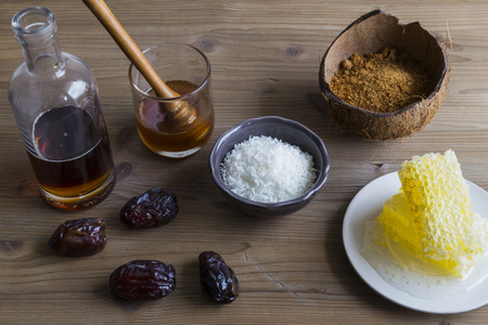 Selection of sweetener ingredients including honey sugar and maple syrup