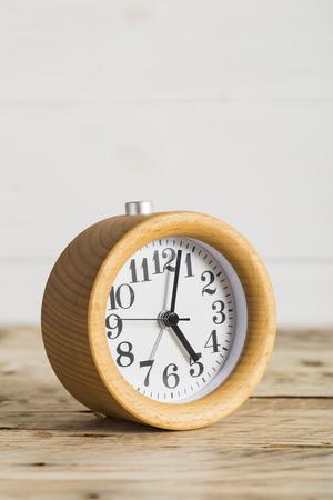 bedside: Wooden bedside alarm clock Stock Photo