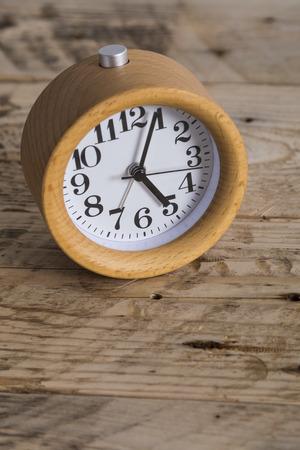 bedside: Wooden bedside clock Stock Photo
