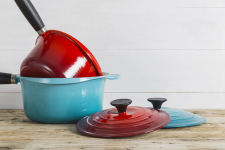 lids: Blue and red saucepans with lids