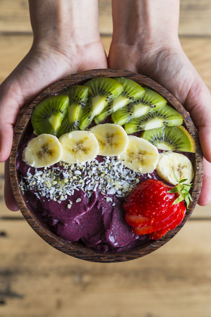 Acai bowl in hands