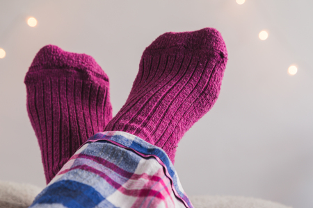 Feet up in pink socks crossed over each other