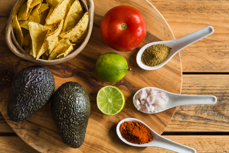 Tortilla chips and ingredients for guacamole dip Stock Photo