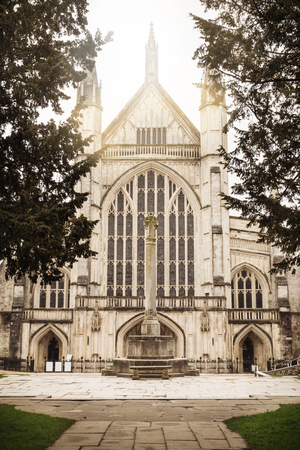 The front facade and entrance to Winchester Cathedral in Hampshire, UK.