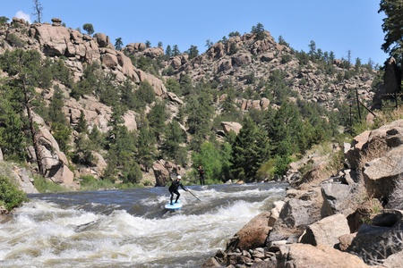 2 Stand up paddleboarders attempt the fury of Zoom Flume rapid of the Arkansas River.  The flow is 3000 CFS,  near Buena Vista, CO.
