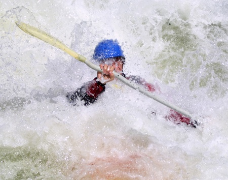 A dynamic shot of a whitewater kayaker challenging the rapids of Gore Canyon.