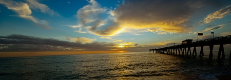 Sunset on the Gulf of Mexico, pier at Venice Beach Florida, USA