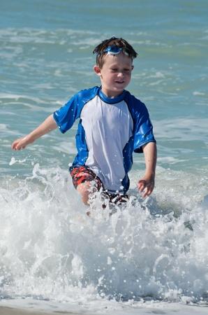 Splashing fun in the ocean 写真素材