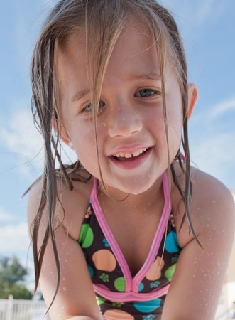 A cute young girl up close in summertime setting