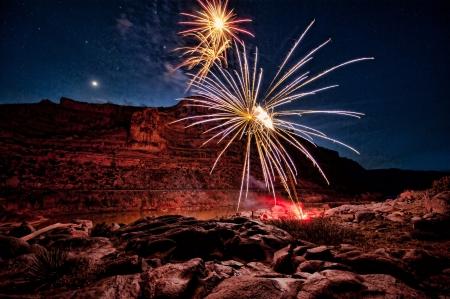 HDR image - firework display in deep canyon 写真素材