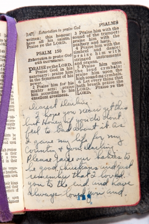 Bible with love letter written, purple place marker added for color 写真素材